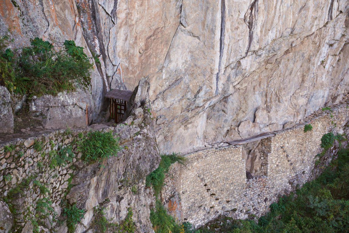 Ancient inca bridge in Machu Piccchu lost city Peru
