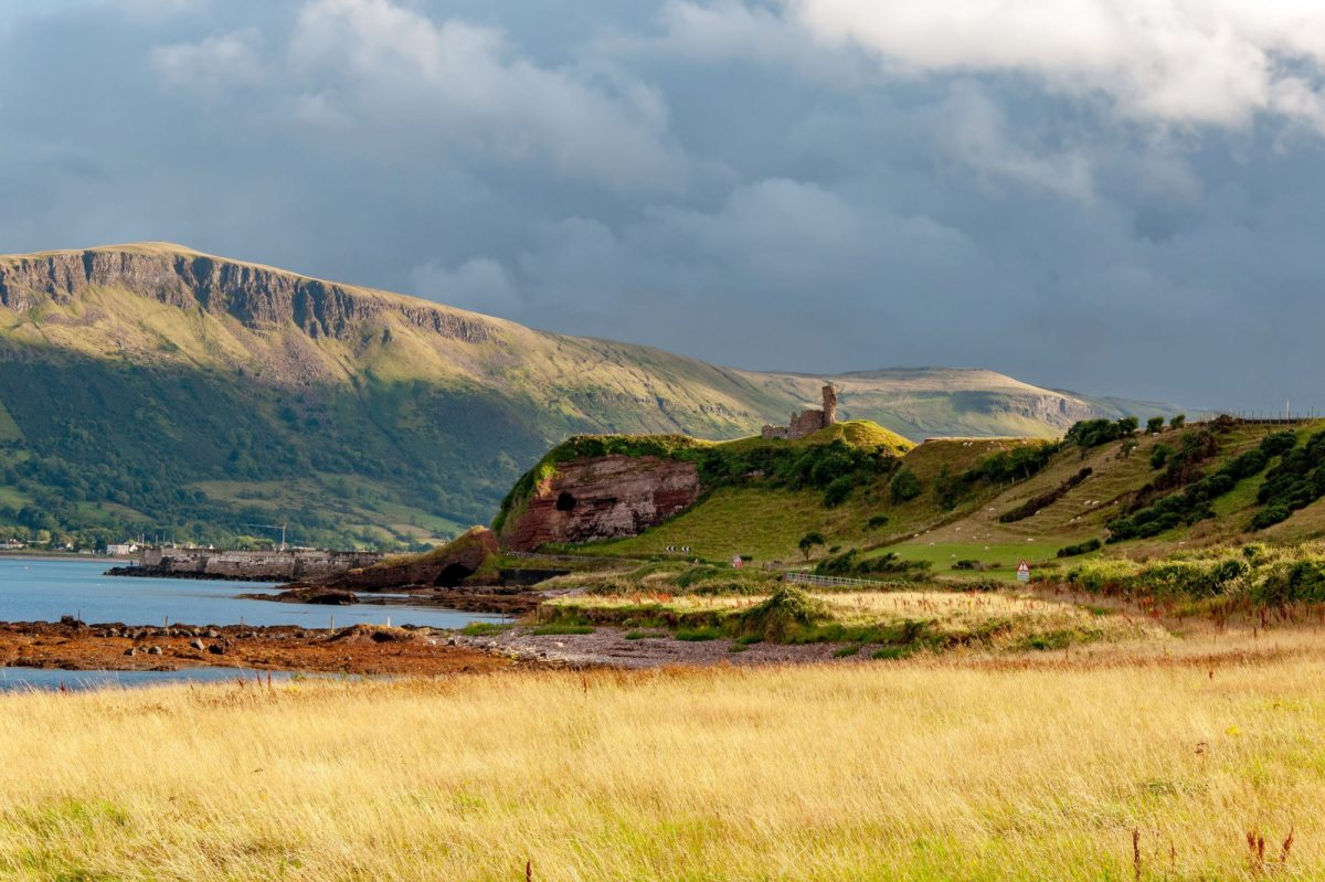 Antrim Glens Western coast of County Antrim Northern Ireland UK with the ruin of medieval Red Bay Castle