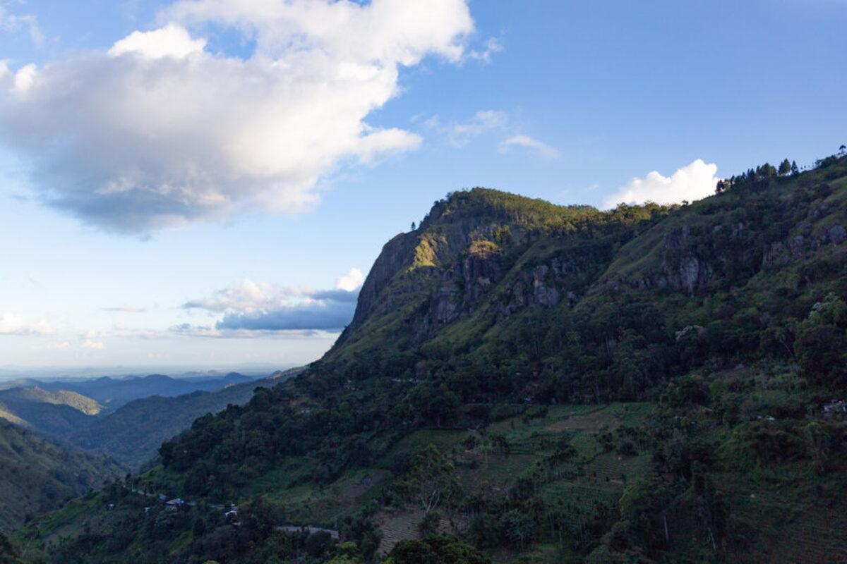 Ella Sri Lanka mountain gap landscape against blue skies with clouds Adams Peak