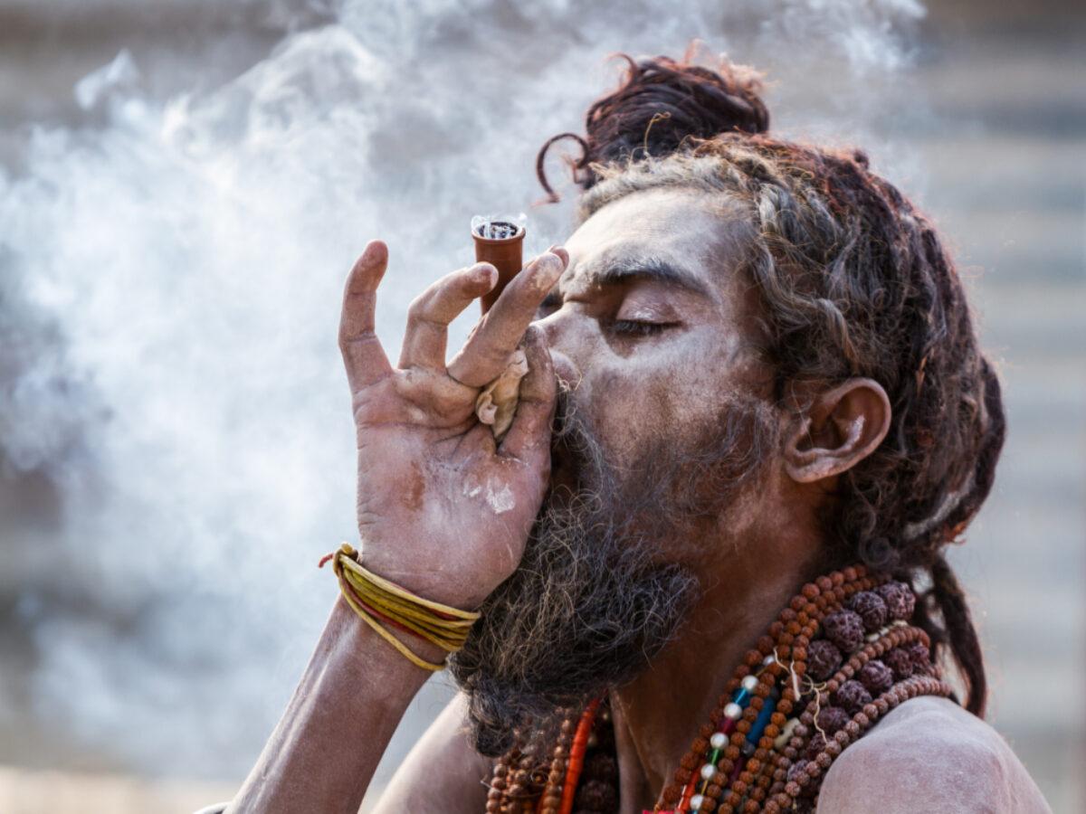 India Allahabad A Hindu sadhu smokes a hash pipe during the festival of Kumbha Mela