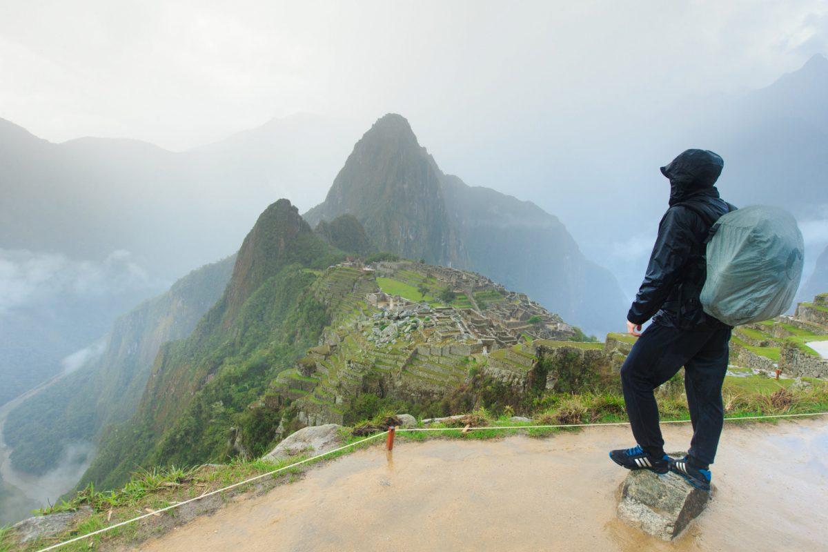 Tourist looking over Machu Picchu Peru
