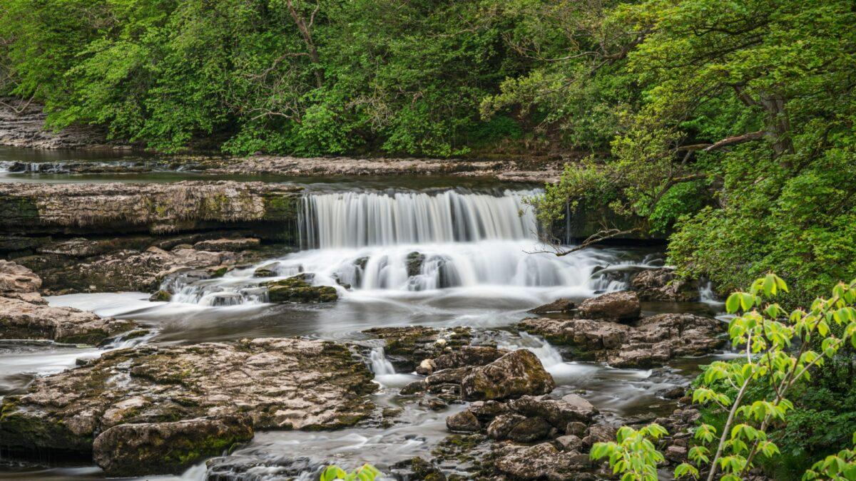 Family Aysgarth Falls Yorkshire Dales UK